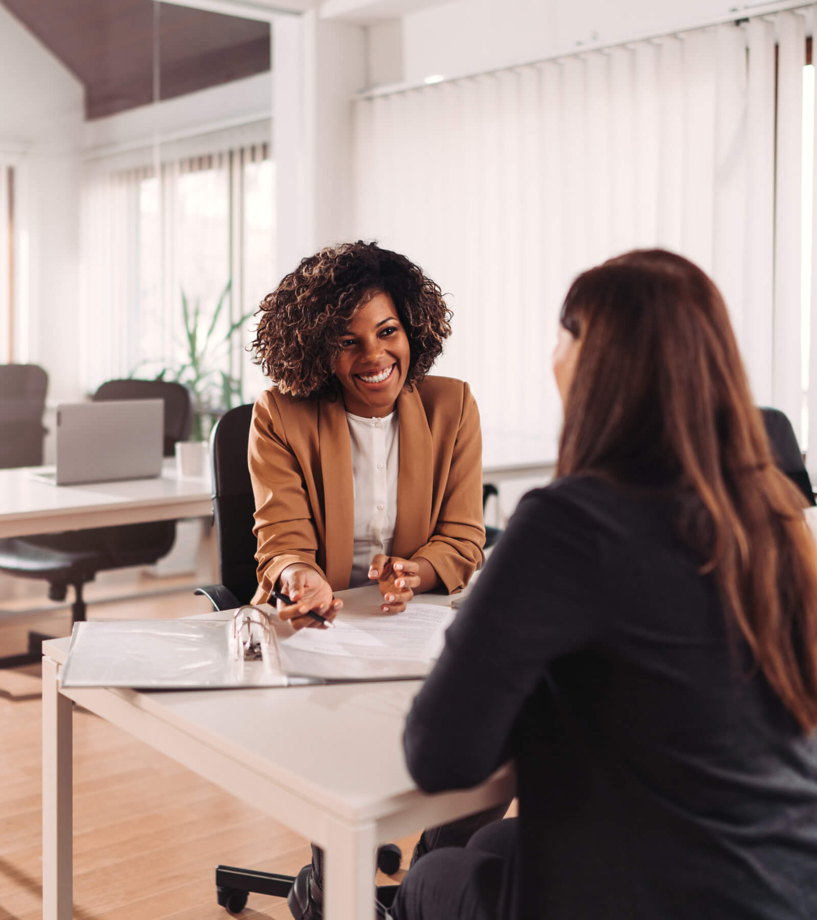 A consumer speaking with a credit union manager