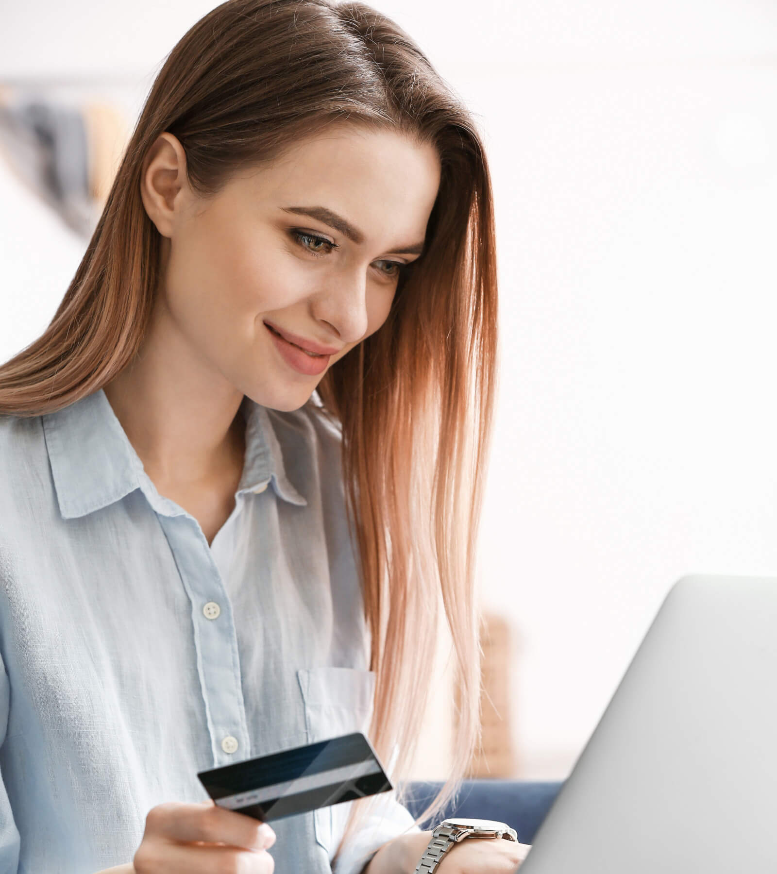A happy women making an online payment with her credit card